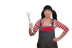 Female worker holding a wrench. Brunette woman with a wrench in his hand Royalty Free Stock Image