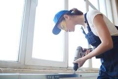 Female Worker Installing Windows Royalty Free Stock Photo