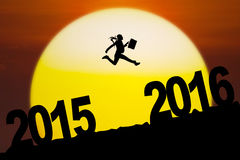 Female worker jumping toward 2016 numbers Royalty Free Stock Photos