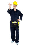 Female worker in jumpsuit showing perfect gesture Royalty Free Stock Photo