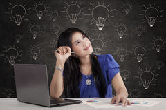 Female worker and lamps Stock Photography