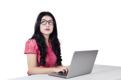 Female worker with laptop and looking at copyspace Stock Photography