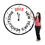 Female worker makes resolution clock Stock Photo