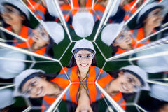Female worker in mirrow reflection Stock Photos