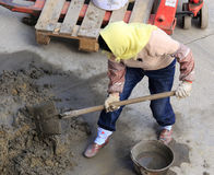 Female worker mixing cement Royalty Free Stock Image