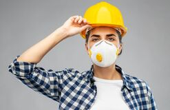 Free Female Worker Or Builder In Helmet And Respirator Royalty Free Stock Photos - 182919488