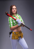 Female worker in overalls holding an axe Royalty Free Stock Photo