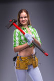 Female worker in overalls holding an axe Royalty Free Stock Photography