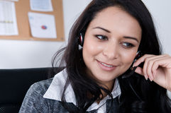 Female Worker on the phone. Attractive female worker on the phone. Shot with Hi Res Camera royalty free stock image