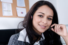 Female Worker on the phone. royalty free stock photo