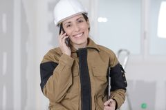 Female worker on phone at construction site Stock Photo