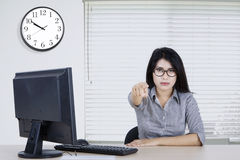Female worker pointing finger at you Stock Photo