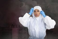 Female worker in pollution protection suit stock image