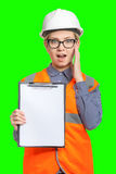 Female worker portrait. Isolated female worker portrait on the green background Stock Photography