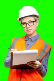 Female worker portrait. Isolated female worker portrait on the green background Royalty Free Stock Photo