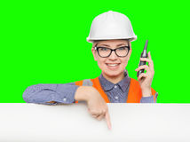Female worker portrait. Isolated female worker portrait on the green background Stock Image
