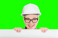 Female worker portrait. Isolated female worker portrait on the green background Royalty Free Stock Image