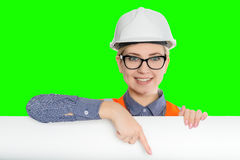 Female worker portrait. Isolated female worker portrait on the green background Stock Photo