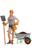 Female worker posing with a shovel royalty free stock images