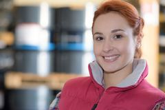 Female worker posing in warehouse Royalty Free Stock Photo