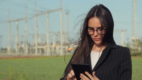 Female worker at power plant. With computer tablet. Business woman in eyeglasses stock video footage