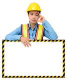 Female worker with Protection Equipment, posing behind big white Royalty Free Stock Photos