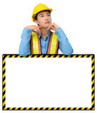 Female worker with Protection Equipment, posing behind big white Stock Images