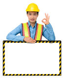 Female worker with Protection Equipment, posing behind big white Royalty Free Stock Photo