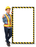Female worker with Protection Equipment, posing side of big whit Royalty Free Stock Photography