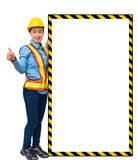 Female worker with Protection Equipment, posing side of big whit Royalty Free Stock Photos