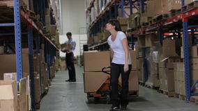 Female Worker Pulling Pallet In Warehouse stock video