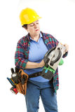 Female Worker Repairs Saw royalty free stock image