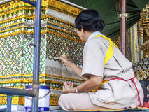 Female worker restores a mosaique royalty free stock photography