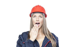 Female worker with safety helmet. Isolated on white background Royalty Free Stock Photography