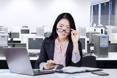 Female worker with schedule book in office Royalty Free Stock Photos