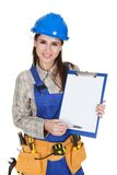 Female worker showing blank clipboard Royalty Free Stock Photo