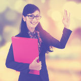 Female worker shows okay sign Royalty Free Stock Photography