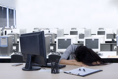 Female worker sleeps in the workplace Royalty Free Stock Images