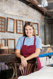 Female Worker Smiling While Leaning On Chair In Royalty Free Stock Photography