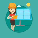 Female worker of solar power plant. Royalty Free Stock Images
