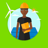 Female worker of solar power plant and wind farm. Stock Photos