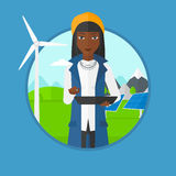 Female worker of solar power plant and wind farm. Stock Images