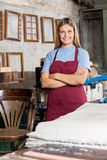 Female Worker Standing Arms Crossed In Paper Royalty Free Stock Images