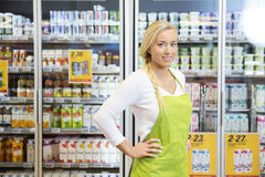 Female Worker Standing With Hands On Hip In Grocery Store Royalty Free Stock Photography