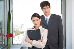 Female Worker Standing With Her Colleague Stock Photography