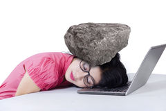 Female worker with a stone on her head Stock Photos