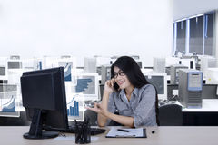 Female worker talks growth charts by phone Stock Images