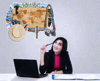Female worker thinking famous places to vacation Royalty Free Stock Photos