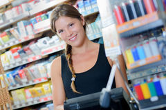 Female worker in tobacconist. Female worker in a tobacconist Royalty Free Stock Photo