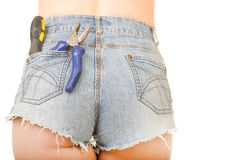 Female worker with tools. In back pocket on shorts Royalty Free Stock Photos